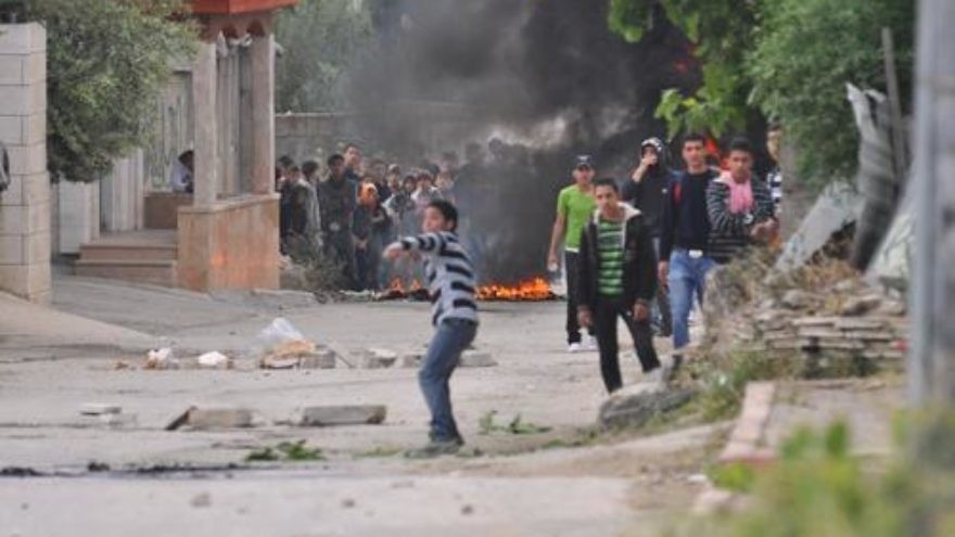 Click photo to download. Caption: Palestinian rioters hurl rocks and firebombs at Israeli security forces in El-Arrub, southwest of Bethlehem. Credit: Israel Defense Forces.