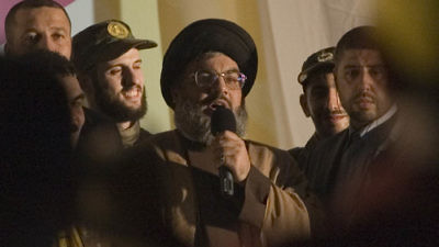 Hassan Nasrallah, leader of the Lebanese terror group Hezbollah, makes a rare public appearance in a suburb of Beirut in July 2008. Credit: Ferran Queved/Flash90.