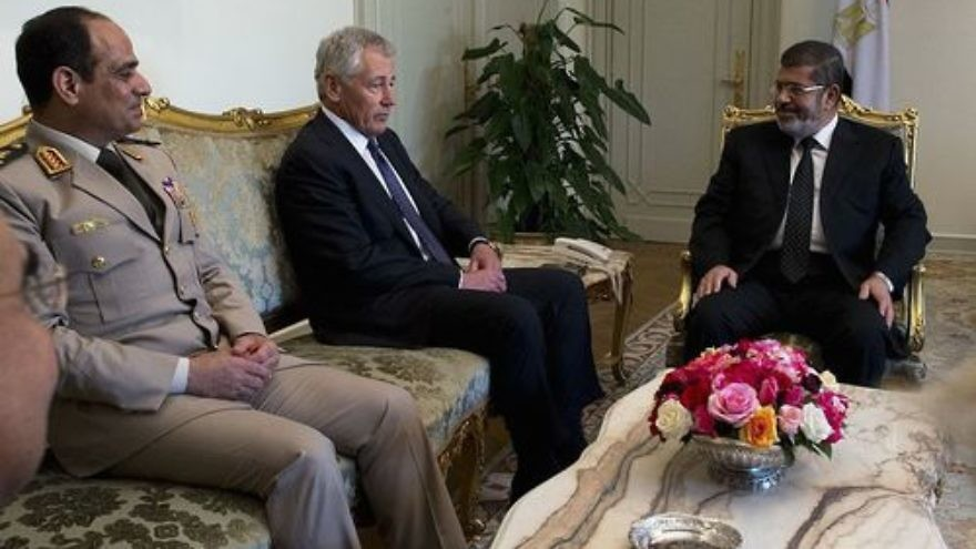 From left to right, former Egyptian defense minister Abdel Fattah El-Sisi, former U.S. defense secretary Chuck Hagel, and former Egyptian president Mohammed Morsi meet in Cairo on April 24, 2013. El-Sisi, who is now Egypt's president, was instrumental in bringing about Morsi's ouster in July 2013. Credit: Erin A. Kirk-Cuomo via Wikimedia Commons.