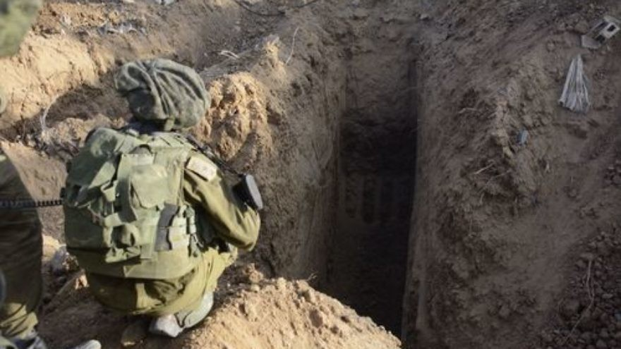 "An Israeli soldier overlooks a Hamas tunnel in Gaza in July 2014, during ""Operation Protective Edge."" Credit: Israel Defense Forces."