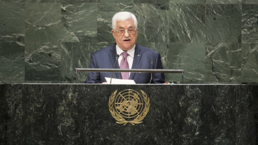"In the aftermath of Palestinian Authority leader Mahmoud Abbas (pictured here addressing the U.N. General Assembly in September 2014) signing the Rome Statute to join the International Criminal Court (ICC), the ICC has launched an inquiry requested by the Palestinians into alleged Israeli ""war crimes."" Credit: U.N. Photo/Amanda Voisard."