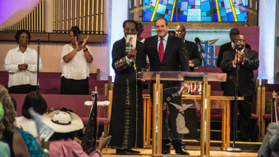 Click photo to download. Caption: In August 2015 in Detroit, Rabbi Yechiel Eckstein (center right, at podium), founder and president of the International Fellowship of Christians and Jews, visits the New St. Paul Tabernacle Church of God in Christ, which is part of the nation's largest black Pentecostal denomination. Credit: Justin McMahan.