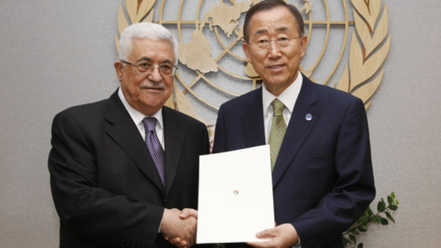 U.N. Secretary-General Ban Ki-moon (right) and Palestinian Authority leader Mahmoud Abbas pose for a photograph in September 2011 after Abbas submitted a formal application for P.A. .status as a U.N. member state. In early January 2015, Ban announced the approval of the P.A.'s request to join the U.N.-affiliated International Criminal Court, a body through which the P.A. intends to bring war crimes charges against Israel. Credit: U.N. Photo/Paulo Filgueiras.