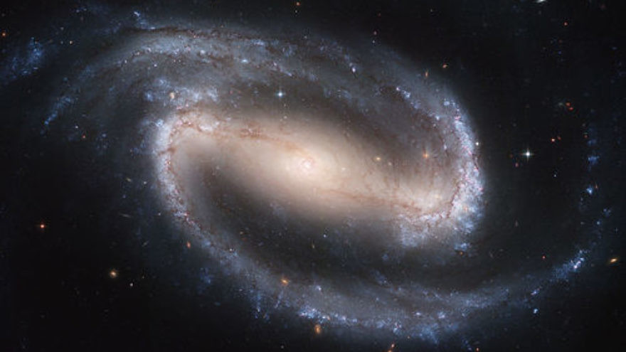 "Click photo to download. Caption: NGC 1300, a spiral galaxy, as photographed by the Hubble telescope. Chemist Dr. Andre Danesh writes that ever since the first time he read about Big Bag theorist Alan Guth, he has been interested in discovering what exactly came before the Big Bang. Danesh's conclusion, which he calls the ""theory of everything from nothing,"" affirms the Judeo-Christian narrative that God greater the universe. Credit: NASA, ESA, and The Hubble Heritage Team STScI/AURA."