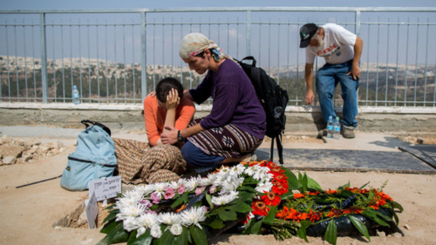 Click photo to download. Caption: Israelis mourn at the grave of murdered Jewish couple Na'ama and Eitam Henkin after their funeral at Har HaMenuchot Cemetery in Jerusalem on Friday, Oct. 2, 2015. Credit: Yonatan Sindel/Flash90.