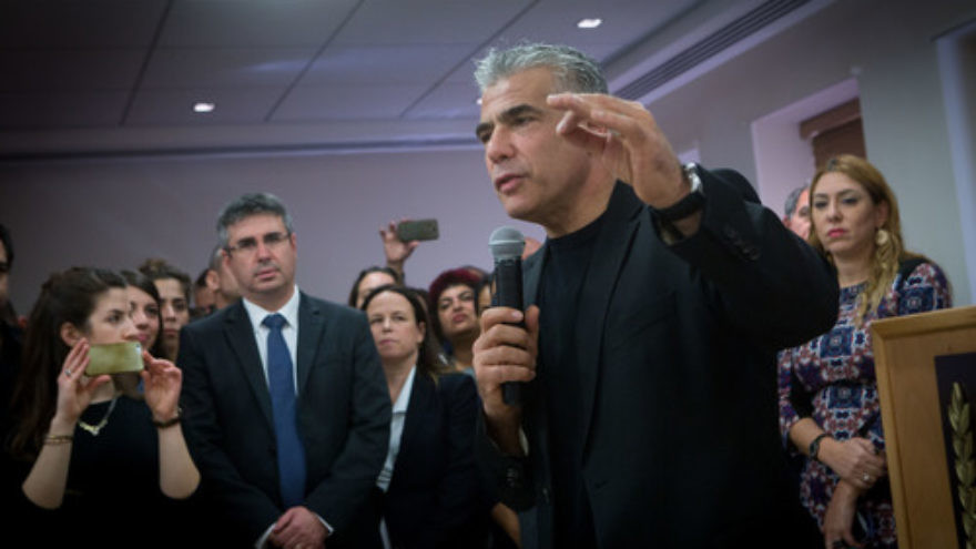 Jettisoned Israeli finance minister Yair Lapid, leader of the Yesh Atid Party, speaks during a farewell party on Dec. 4 in his honor at the Ministry of Finance in Jerusalem. Lapid and Justice Minister Tzipi Livni were dismissed from Israeli Prime Minister Benjamin Netanyahu's coalition on Dec. 2, 2017. Credit: Miriam Alster/Flash90.