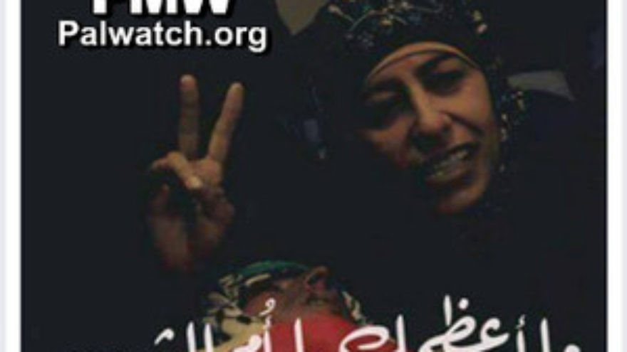"Click photo to download. Caption: In this photo published on the Facebook page of the Palestinian Fatah faction, the mother of late Palestinian terrorist Muhammed Shamasneh makes a ""V"" sign with her right hand. The caption reads, ""How great you are, O mother of the Martyr."" Credit: Palestinian Media Watch."