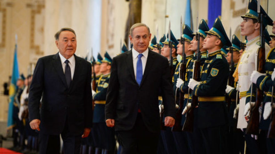 Israeli Prime Minister Benjamin Netanyahu (center) and Kazakh President Nursultan Nazarbayev (left) are welcomed at Kazakhstan's President's Palace Dec. 14, 2016. Credit: Haim Zach/GPO.