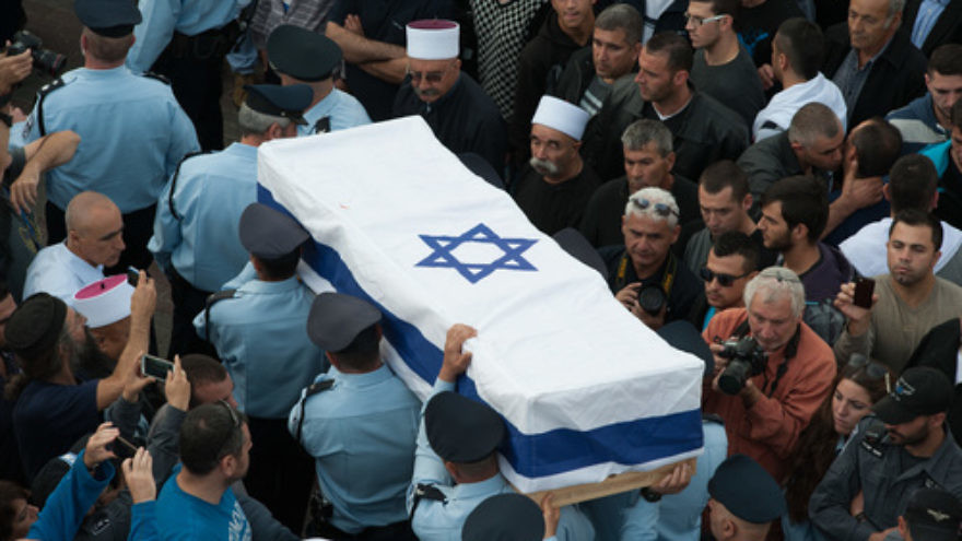 Members of the Israeli police carry the coffin of Druze police officer Zidan Saif during his funeral in the northern village of Yanuh-Jat on Nov. 19. Saif was killed while trying to save Jewish worshippers from Palestinian terrorists who attacked a Jerusalem synagogue on Nov. 18. Credit: Flash90.