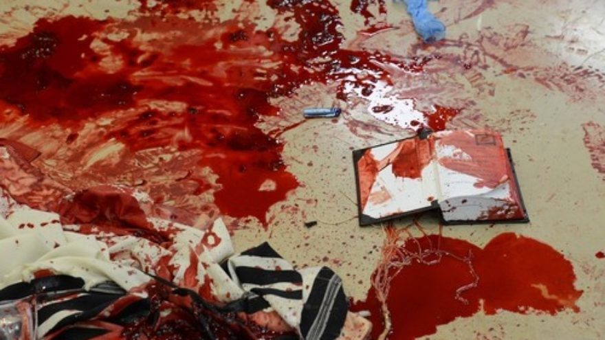 Click photo to download. Caption: Blood on prayer shawls and a siddur inside the Kehilat Bnei Torah synagogue in Jerusalem following the terrorist attack that took place there on Nov. 18, 2014. Cerdit: Kobi Gideon/GPO/FLASH90.