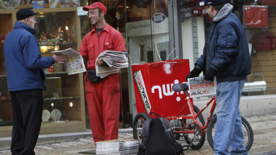Click photo to download. Caption: Distribution of the free newspaper Israel Hayom on Ben Yehuda Street in Jerusalem. Credit: Miriam Alster/Flash90.