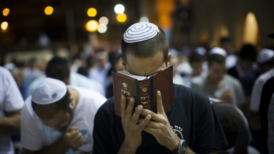 Click photo to download. Caption: Selichot (forgiveness) prayers at the Western Wall in the Old City of Jerusalem on August 31, 2013, prior to Rosh Hashanah that year. Credit: Yonatan Sindel/Flash90.