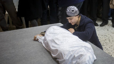 Adva Biton, mother of Adele Biton, a 4-year-old Israeli Jewish victim of a Palestinian stoning attack, cries over her daughter's body in February 2015. Photo by Yonatan Sindel/Flash90.