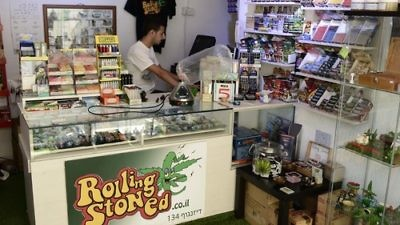 """Click photo to download. Caption: Inside """"Rolling Stoned,"""" a Tel Aviv-based smoke shop that offers Israel's largest variety of smoking and vaporizing paraphernalia for medical marijuana and tobacco. Credit: Tomer Neuberg/Flash90."""