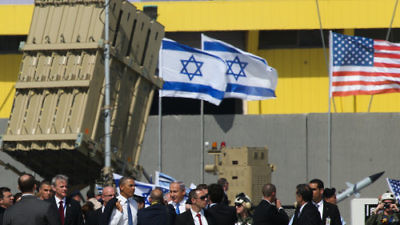 In March 2013 near Tel Aviv, American and Israeli officials, including U.S. President Barack Obama and Israeli Prime Minister Benjamin Netanyahu, are pictured next to a battery of the Iron Dome, Israel's U.S.-funded missile-defense system. Credit: Nati Shohat/Flash90.