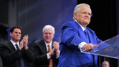 "Christians United for Israel founder Pastor John Hagee addresses the 33rd annual ""A Night to Honor Israel"" in San Antonio on Sunday. Behind him are Israeli Ambassador to the U.S. Ron Dermer (left) and popular radio talk show host Dennis Prager, who both also spoke at the event. Credit: Paul Wharton Photography."
