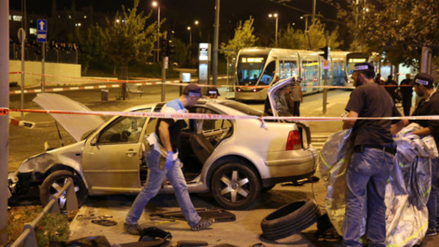 Click photo to download. Caption: Police and resuce personnel at the scene where a car crashed into Jerusalem's Ammunition Hill light rail station in a terror attack on October 22, 2014. Credit: Flash90.