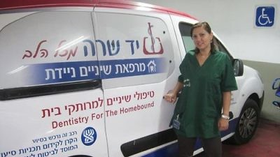 Click photo to download. Caption: One of Yad Sarah's vans, which provide mobile dental clinics in three cities in Israel. Credit: Yad Sarah.