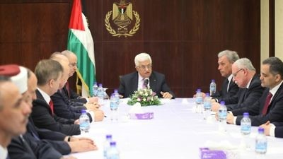 Palestinian Authority leader Mahmoud Abbas (center) meets with the new Fatah-Hamas unity government in the West Bank city of Ramallah on June 2, 2014. Credit: Issam Rimawi/Flash90.