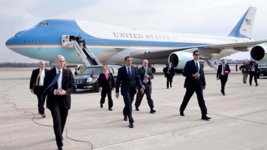 Click photo to download. Caption: President Barack Obama, surrounded by Secret Service personnel, arrives at Port Columbus International Airport in Columbus, Ohio, on March 6, 2009. Credit: Pete Souza/White House.