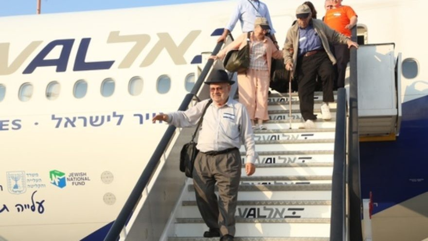 Click photo to download. Caption: Holocaust survivor Jose (Yosef) Lefkowitz, pictured in front, arrives in Israel after making aliyah two years ago. Credit: Sasson Tiram/Nefesh B'Nefesh.