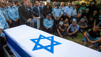 Israel's Public Security Minister Gilad Erdan speaks at the funeral of Druze police officer Kamil Shnaan in the northern village of Hurfeish, July 14, 2017. Shnaan was one of two Druze police officers killed by Arab terrorists last Friday near the Temple Mount in Jerusalem. Credit: Basel Awidat/Flash90.