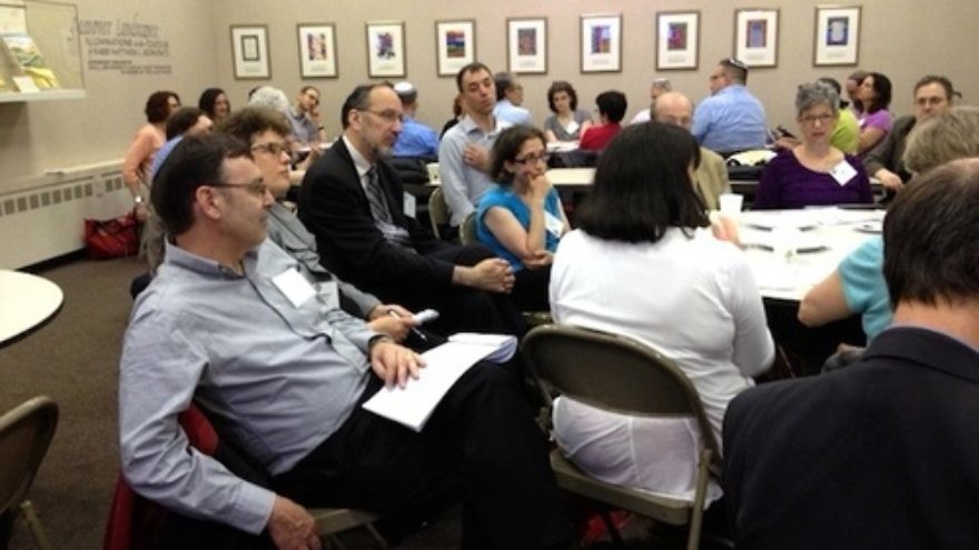 Click photo to download. Caption: On June 3, 2013, participants at the Network for Research in Jewish Education conference discuss Consortium for Applied Studies in Jewish Education research agendas around Jewish educational leadership, Israel education, and the sustainability of Jewish education. Credit: Wendy Rosov.