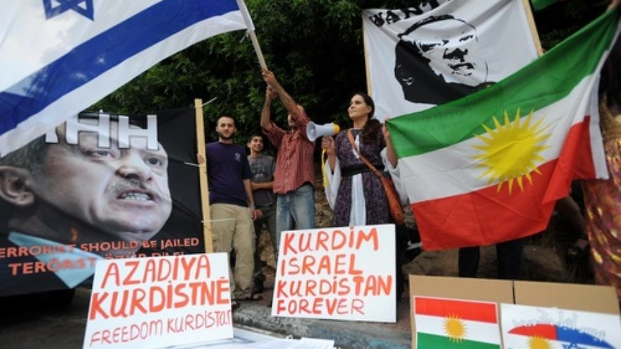 Click photo to download. Caption: Israelis hold up placards, including a portrait of Turkey's Prime Minister Recep Tayyip Erdogan labeled wanted, during an anti-Turkish protest outside the Turkish embassy in Tel Aviv on July 8, 2010. Credit: Gili Yaari/Flash 90.