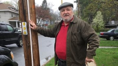 Harold Warren, second vice president of the historic Congregation Schomre Israel, stands at one of the boundaries for the new eruv in Poughkeepsie, N.Y. Credit: Courtesy of Harold Warren.
