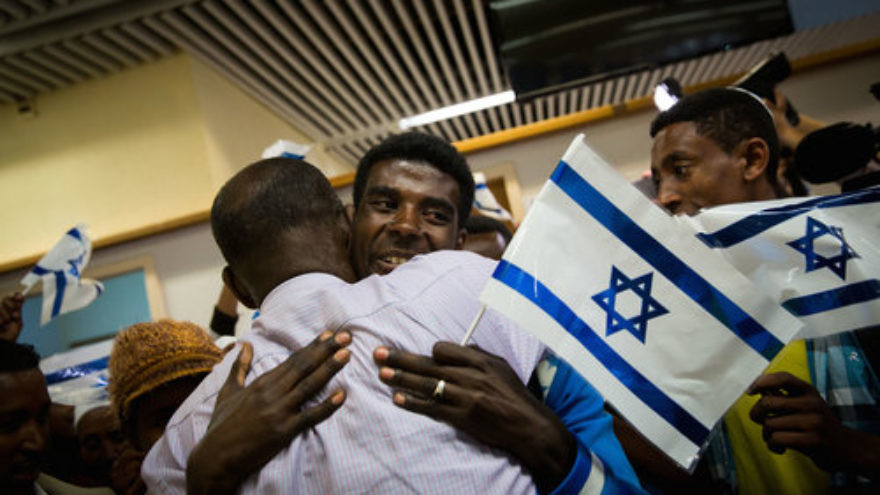Ethiopian Jews rejoice upon their arrival in Israel Oct. 9, 2016. Israel is the only country in the world to ever sent its planes to a famine-ravaged African country such as Ethiopia to airlift tens of thousands of starving blacks to safety, notes columnist Stephen M. Flatow. Credit: Miriam Alster/Flash90.