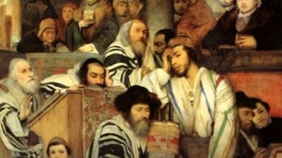 Click photo to download. Caption: Jews praying in synagogue on Yom Kippur. Credit: Wikimedia Commons