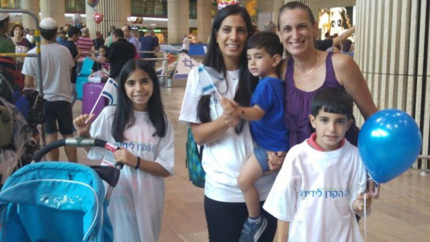 Venezuelan Jew Michal Levy and her three children, along with Debbie Ashkenazi (right), coordinator of aliyah from Latin America for the International Fellowship of Christians and Jews, after the Levy family arrived in Israel Wednesday. Credit: International Fellowship of Christians and Jews.