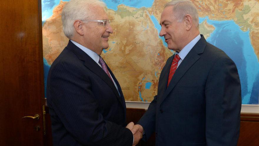 U.S. Ambassador to Israel David Friedman (left) greets Israeli Prime Minister Benjamin Netanyahu. Credit: GPO.
