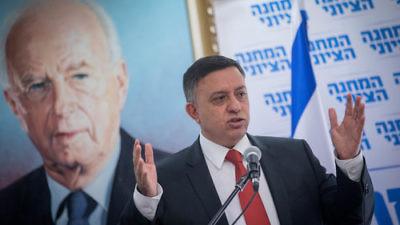 Avi Gabbay, head of the Zionist Union alliance and the Labor party, leads a Zionist Union meeting at the Israeli Knesset on Nov. 20, 2017. In the background is a photo of Yitzhak Rabin,  the former Israeli prime minister and Labor leader. Credit: Yonatan Sindel/Flash90.