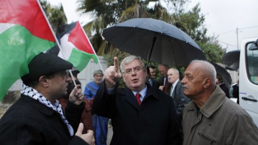 Irish Foreign Minister Eamon Gilmore gestures while talking with Palestinian demonstrators at the weekly gathering in the mostly Arab neighborhood of Sheikh Jarrah in eastern Jerusalem on Jan 27, 2012. Within an Irish government that frequently condemns Israel for its treatment of the Palestinians, Gilmore is one of the most outspoken critics of the Jewish state. Credit: Sliman Khader/FLASH90.