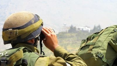 An Israeli soldier patrols near the Israel-Syria border in the Golan Heights. Credit: IDF.