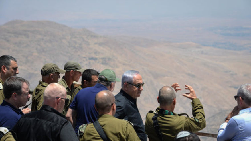 Israeli Prime Minister Benjamin Netanyahu (in front, third from right) and Israeli defense officials tour the Jewish state's northern border with Syria in the Golan Heights, July 25, 2017. Credit: Kobi Gideon/GPO/Flash90.