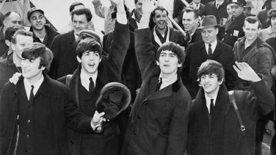 """Click photo to download. The Beatles, pictured here waving to fans after arriving at John F. Kennedy Airport in New York in February 1964, makes the JNS.org Hanukkah playlist with """"Eight Days A Week."""" Credit: Library of Congress."""