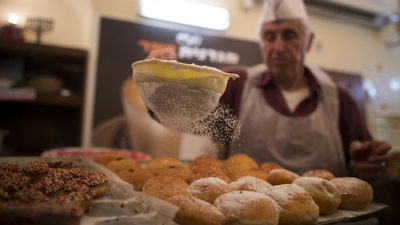 Sufganiyot (deep-fried doughnuts) are made at the Jerusalem-based Magdinat Pe'er bakery Nov. 26, 2012, leading up to Hanukkah. Credit: Yonatan Sindel/Flash90.