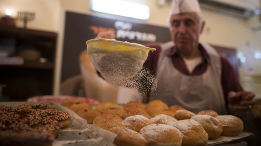 Sufganiyot (deep-fried doughnuts) are made at the Jerusalem-based Magdinat Pe'er bakery Nov. 26, 2012, leading up to Hanukkah. Credit: Yonatan Sindel/Flash90.