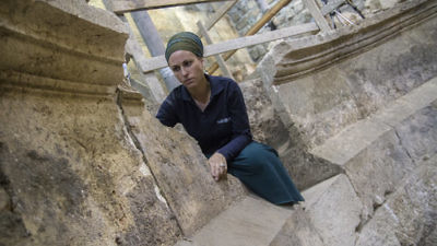Israel Antiquities Authority archaeologist Tehillah Lieberman at the newly discovered ancient Roman theater in Jerusalem. Credit: Yaniv Berman/Israel Antiquities Authority.