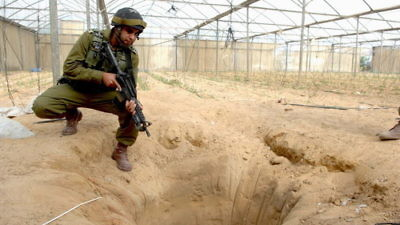 An Israeli soldier pictured in 2006 at a tunnel uncovered during an Israeli counterterrorism operation designated to thwart weapons-smuggling from Egypt to Gaza. Credit: Israel Defense Forces.