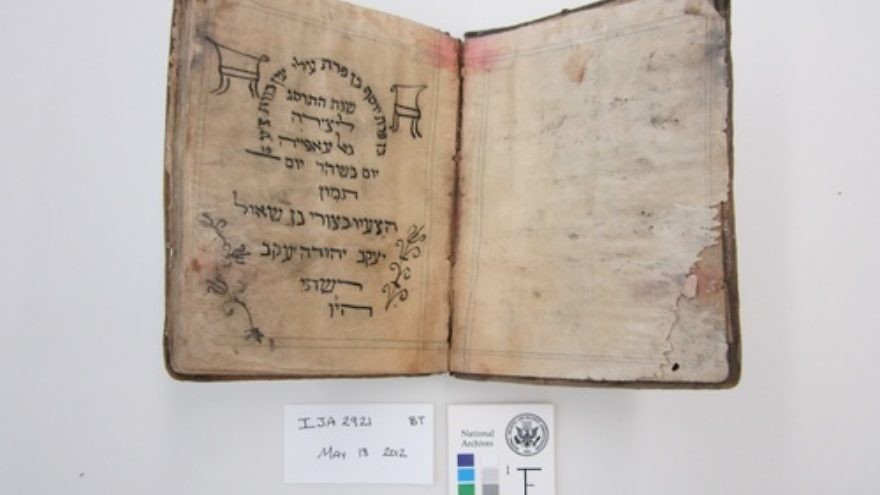 Before treatment by the National Archives and Records Administration, a Passover Haggadah from 1902 recovered from the Mukhabarat, Saddam Hussein's Intelligence Headquarters. The haggadah is part of what has become known as the Iraqi Jewish Archive. Credit: National Archives and Records Administration.