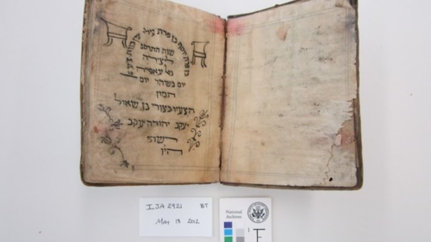 Before treatment by the National Archives and Records Administration, a Passover haggadah from 1902 recovered from the Mukhabarat, Saddam Hussein's Intelligence Headquarters. The haggadah is part of what has become known as the Iraqi Jewish Archive. Credit: National Archives and Records Administration