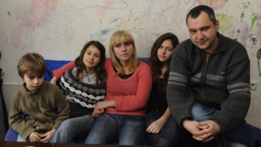 Click photo to download. Caption: With no money to replace the decayed wallpaper in their poorly insulated three-room apartment in Bulgaria, parents Harry and Yana allowed their three children to simply draw on the walls to bring cheer to their home. Economic hardships afflicting Europe pose a dire a threat to Jews, writes Alan H. Gill, CEO of the American Jewish Joint Distribution Committee (JDC). Credit: JDC.
