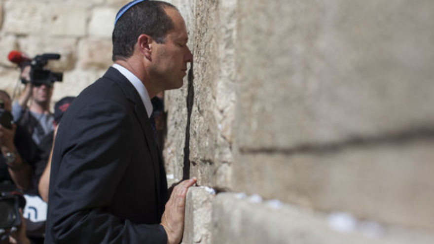 "Jerusalem Mayor Nir Barkat prays at the Western Wall holy site. Barkat says that ""moving the [U.S.] embassy to the capital of the Jewish people, to Jerusalem, is a straightforward, standard thing to do."" Credit: Yonatan Sindel/Flash90."