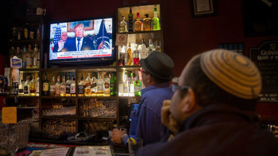 Israelis at a pub in Jerusalem watch a broadcast of President Donald Trump's Dec. 6 announcement on U.S. policy towards Israel's capital. Credit: Yonatan Sindel/Flash90.