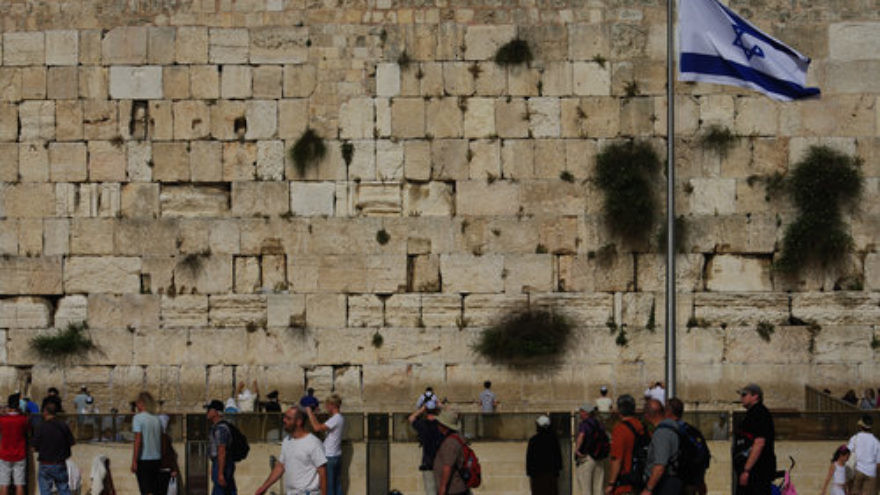 An Israeli flag at the Western Wall in Jerusalem. Credit: Emmanuel DYAN via Wikimedia Commons.