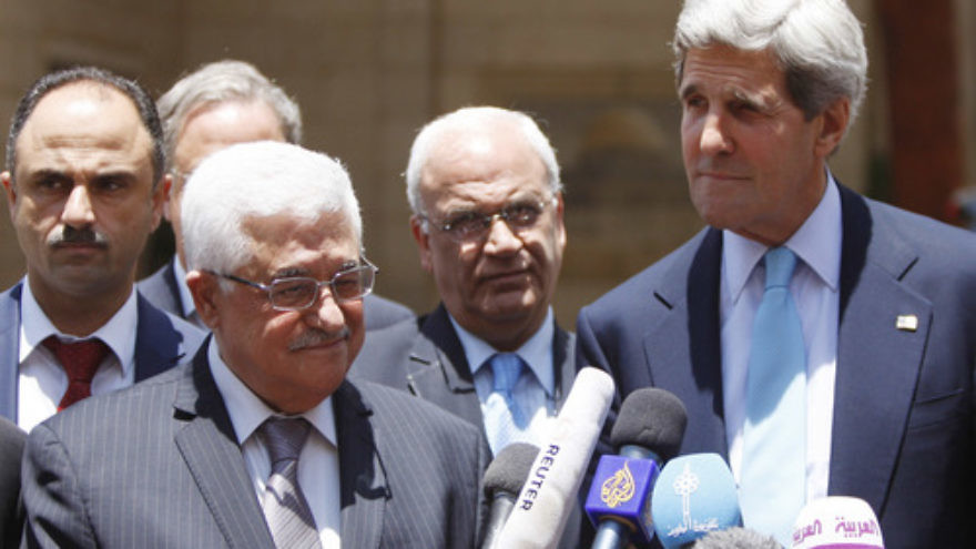 U.S. Secretary of State John Kerry and Palestinian Authority leader Mahmoud Abbas at a press conference following their meeting in Ramallah on June 30, 2013. Credit: Issam Rimawi/Flash90.