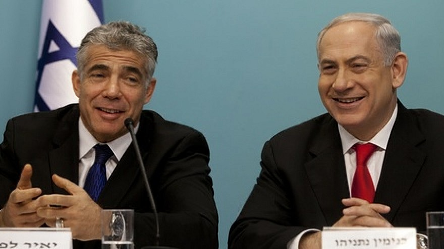 Israeli Prime Minister Benjamin Netanyahu (right) and then Finance Minister Yair Lapid during a press conference on July 3, 2013.